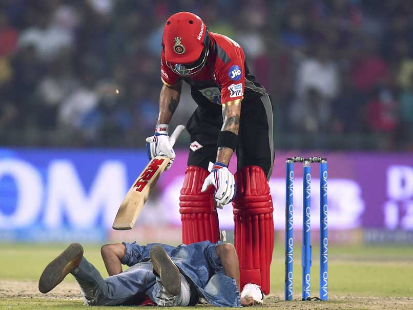 IPL: Fan Breaches Security To Touch Virat Kohli