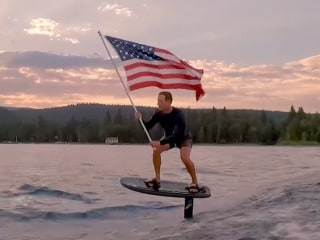 Mark Zuckerberg Celebrates July 4 Holding the US National Flag Aloft in This Wake Foiling Video
