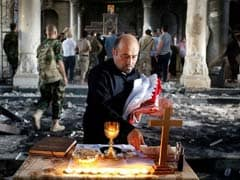 In Charred Church Near Mosul, Iraqi Christians Pray Once More