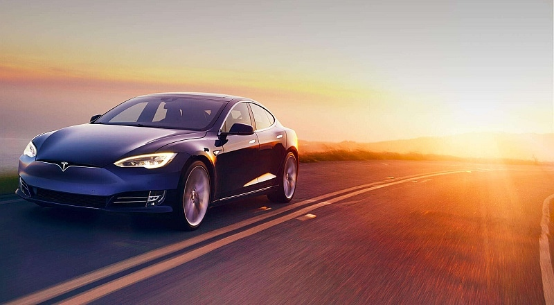 Tesla Says It Will Roll Out Uber-Style Ride Services Program
