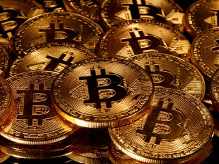 Bitcoin Hits Nearly Three-Year Peak, Homes in on Record