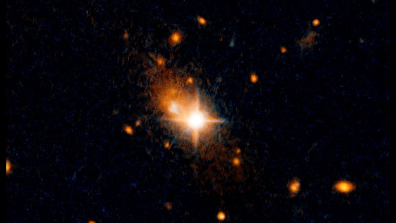 NASA's Hubble Detects Supermassive Black Hole That Was Kicked Out of Galactic Core by Gravitational Waves