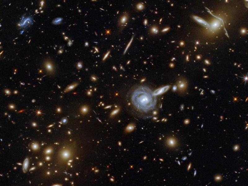 NASA's Hubble Telescope Captures Image Of Galaxy Cluster 3.5 Billion Light-Years Away