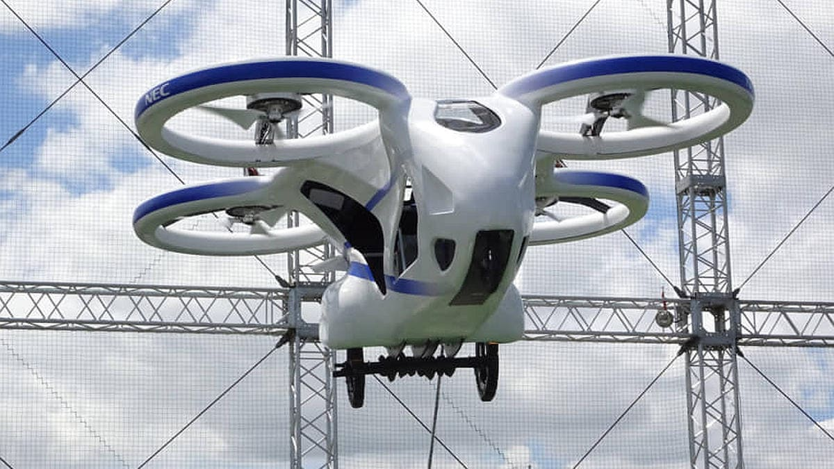 NEC Unveils Flying Car Prototype in Japan, Hovers 10 Feet Above Ground for a Minute in Public Test - Gadgets 360 thumbnail