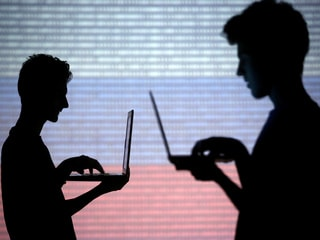 Government Defends Snooping, Citing Grave Threat to Security
