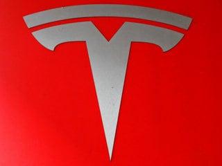 Tesla Says Crash Was Worsened by Missing Freeway Barrier Shield