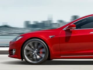 Tesla 'Driver' Turns on Autopilot and Climbs Into the Passenger Seat on British Highway