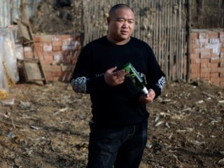 With 'Tornado Beer' and Brick-Breaking, Chinese Villager Becomes Twitter Sensation