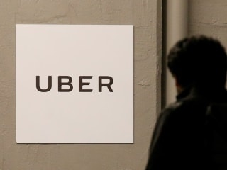Uber, Ola's Indian Legal Woes Put SoftBank's Funding in Firing Line